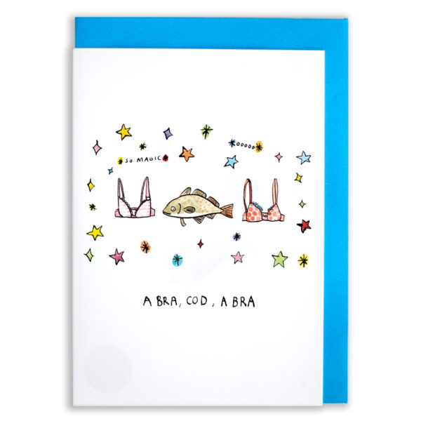 A card with a blue envelope tucked inside. On the front is a cod with a stripy pink bra on one side and a spotty red bra on the other. They are all surrounded by multicoloured stars and sparcles. The words 'so magic' and 'oooo' are floating in the stars. The words 'A Bra, Cod, A Bra' are at the bottom.