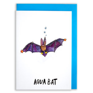 A card with a blue envelope tucked inside. A purple winged bat with long ears is wearing cute little yellow flippers and small orange 'wing' bands. The bat also has a snorkel on with bubbles at the top. Text reads 'Aqua bat'.