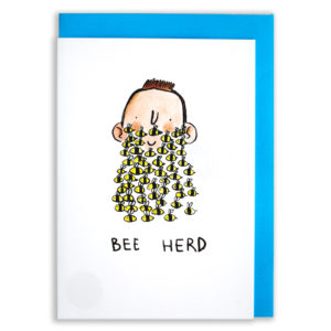 A card with a blue envelope tucked inside. A man with a little smile, sticky up brown hair and bumble bees for a beard. Text below: ' Bee Herd'.