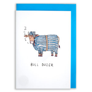 A card with a blue envelope tucked inside. A brown bull, wearing blue and white striped pyjamas and a nightcap, snoring with his eyes closed. Z's are coming from his mouth. Text below reads 'Bull dozer'.