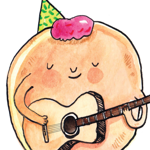 Close up of full image. A round doughnut with pink jam for hair and a green party hat. The doughnut is smiling and holding a guitar.