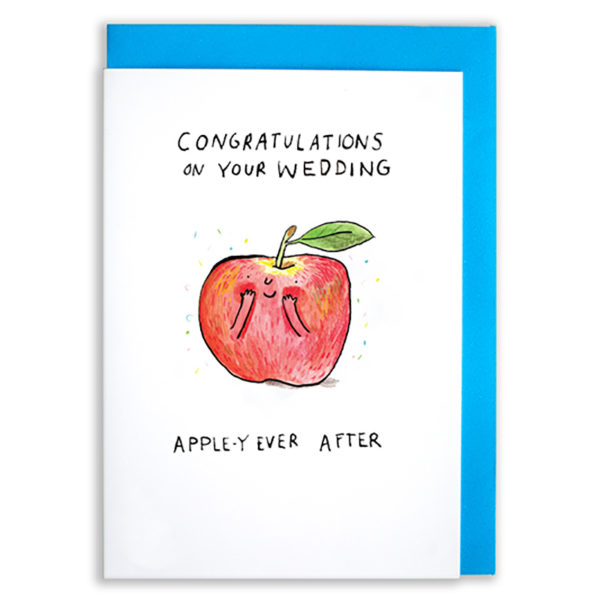 A card with a blue envelope tucked inside. A red apple with arms and a face has its hand covering its cheeks. There is multi coloured confetti around the apple. Text above the apple reads 'Congratulations on your wedding' Text under the apple reads Appley Ever After'