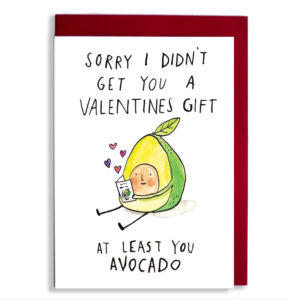Red envelope with card. Text: 'Sorry i didn't get you a valentines gift, at least you avocado'. A little avocado is sat down and reading a card with pink and purple hearts coming out of it.