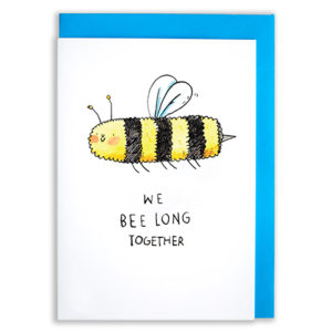 A card with a blue envelope tucked inside. A bumble bee with an extremely long body and a tiny smile. Text reads 'We Belong Together'