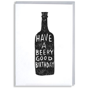 A black silhouette of a beer bottle, inside in white it says 'Have a beery good birthday'.