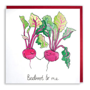 Red envelope with card. Two pinky red beetroots are holding hands and smiling with eyes closed. Text reads 'Beetroot to me'.