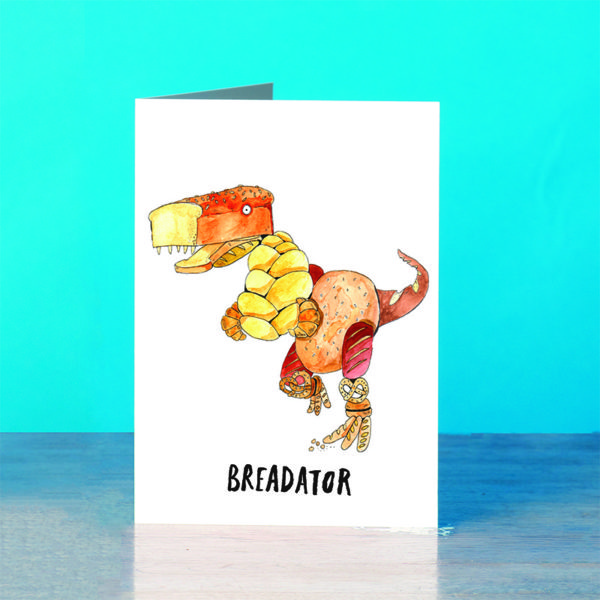A dinosaur made out of different types of bread, text below reads 'breadator'.