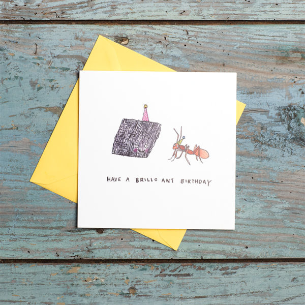 A yellow envelope and card. A brillo pad with a purple party hat is smiling at an ant wearing a yellow hat. Below reads 'Have a brillo ant birthday'.