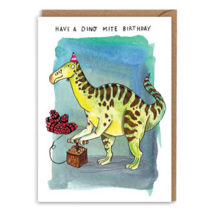 Card with brown envelope. A blue/green watercolour background. A green dinosaur with black stripes is about to push the fuse on a big pile of dynamite! Text above reads 'Have a dino mite birthday'.