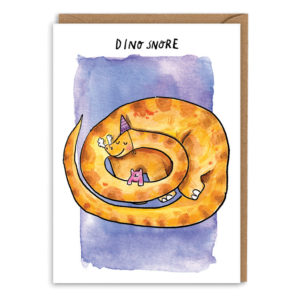 Card with brown envelope. A purple watercolour background. An orange brontosaurus is curled up asleep cuddling a little pink teddy bear, the dino is also wearing a purple party hat. Text reads 'Dino Snore'.