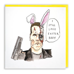 Card with yellow envelope. The terminator is wearing bunny ears. He is saying 'I still love Easter, baby'.
