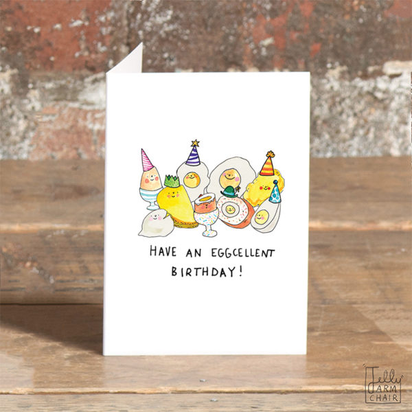 Lots of different types of eggs, fried, boiled, scrambled etc. All are wearing party hats. Text below reads 'Have an eggcellent birthday!'.