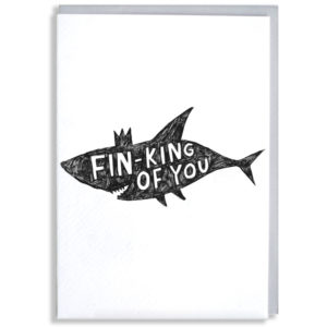 A black silhouette of a shark with a little crown. Inside in white it says 'Fin-king of you'.