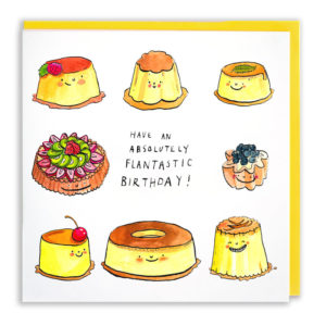Yellow envelope with card. Six different types of flans all with little smiles are surrounding the text 'Have an absolutely flantastic birthday!'.