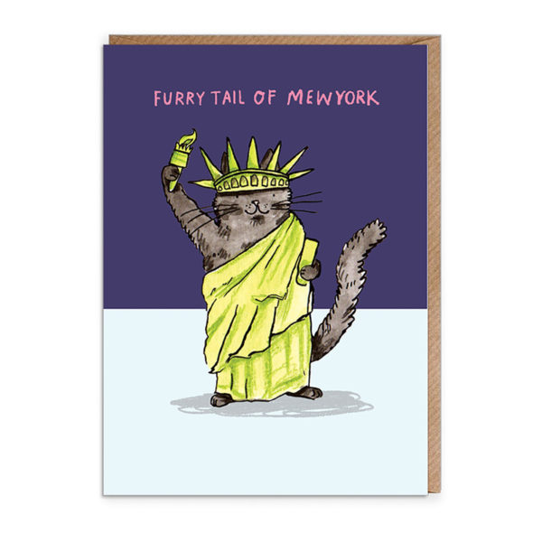 Top half of card dark blue, bottom half light blue. A black cat wearing a green robe and green statue of liberty hat is holding a green fire. Text reads 'Furry Tail of Mewyork'.