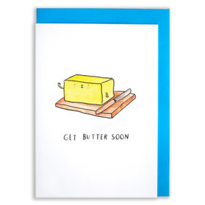 A card with a blue envelope tucked inside. A block of butter with arms is smiling and waving sat on a butter dish next to a butter knife. Text reads, 'Get butter soon'