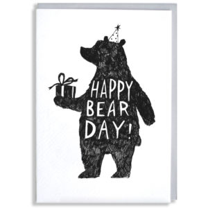 A black silhouette of a bear wearing a party hat and holding a present. Inside the bear in white writing it says 'Happy Bear Day!'.