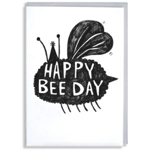 A black silhouette of a black fluffy bee wearing a party hat. Inside in white it says 'Happy bee day'.