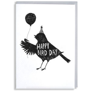 A black silhouette of a bird wearing a party hat and holding a balloon. Inside the bird in white it says 'Happy Bird Day'.