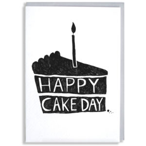 A black silhouette of a cake with one candle. Inside the cake it says 'Happy Cake Day'.
