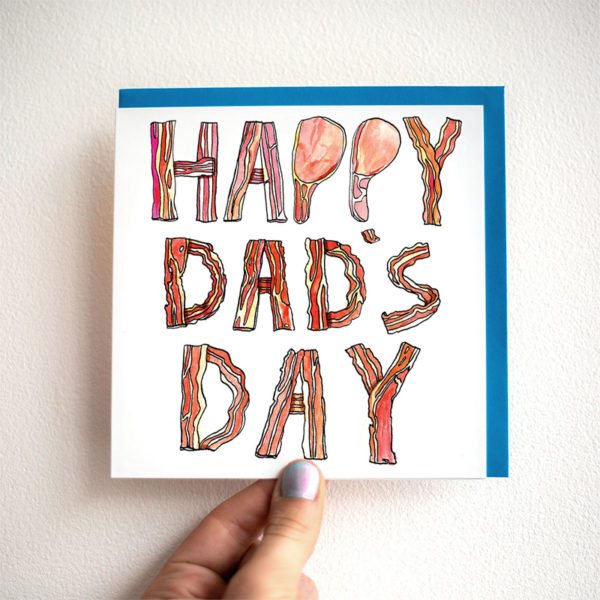 Written in slices of bacon 'Happy Dad's Day'.