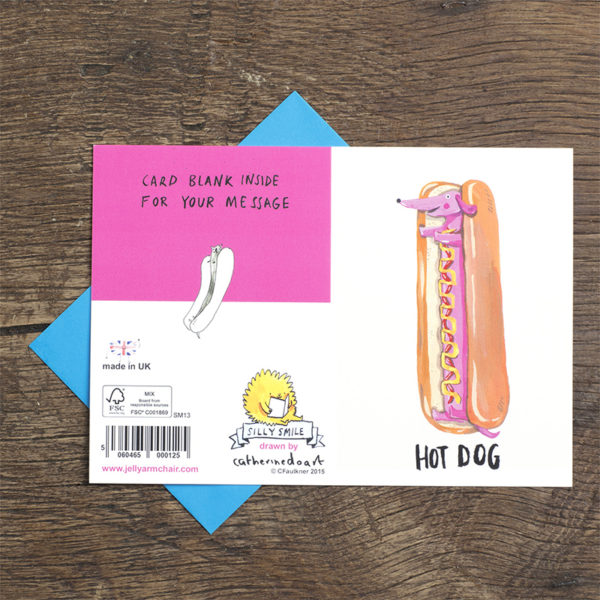 A hot dog, but as a pink dog with ketchup and mustard on his tummy! Text reads 'Hot Dog'. There is a hot dog dog on the back of the card.