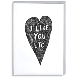 A black silhouette of a heart, inside in white it says 'I like you etc'.