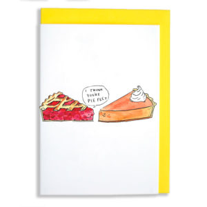 Yellow envelope with card. A slice of pumpkin pie with a dollop of cream is smiling at a slice of cherry pie. The cherry is saying 'I think you're pie fect'.