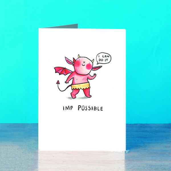 A blue background and a grey wooden table. On the table is a card.A little red imp with rosy red cheeks saying 'I can do it'. Text below reads 'Imp Possible'.