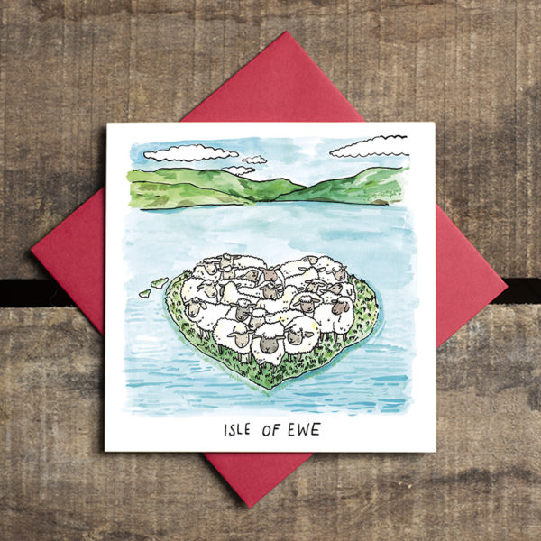 In the middle of a lake surrounded by hills is a little heart shaped island filled with happy, fluffy sheep. Text reads 'Isle of Ewe'.