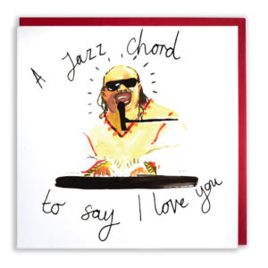 Red envelope with card. A painting of Stevie Wonder, he is playing the keyboard and singing 'I jazz chord, to say, I love you'.