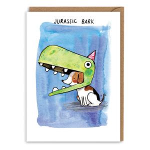 Card with brown envelope. A dark blue watercolour background. Small jack russell wearing a huge dinosaur costume hat, with a little red party hat on top. Text above reads 'Jurassic Bark'.