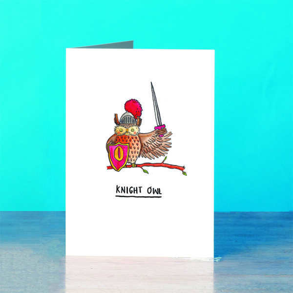 A blue background and a grey wooden table. On the table is a card. An owl with a red shield with a sword with a golden 'O'. The owl also has a helmet on with a red ploom.