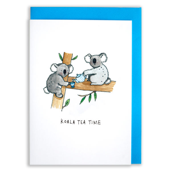 A card with a blue envelope tucked inside. Two koalas in a tree having a cup of tea. One koala has a blue and white striped teapot and is pouring some tea into the other koalas blue and white dotty cup. Both are smily and fluffy and are having fun.