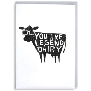 A black silhouette of a cow wearing sunglasses. In the cow in white it says 'you are legendairy'.
