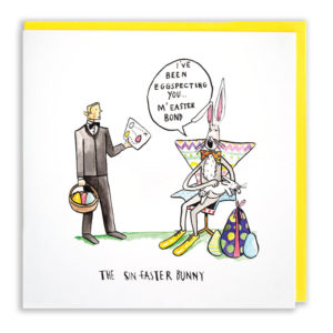 Card with yellow envelope. James bond on an egg hunt. An evil rabbit villain is saying 'I've been eggspecting you m'easter Bond'.