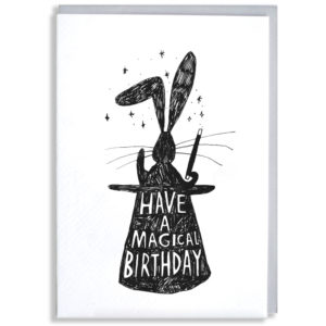 A black silhouette of a rabbit in a top hat holding a want. Inside the hat in white it says 'Have a magical day'.