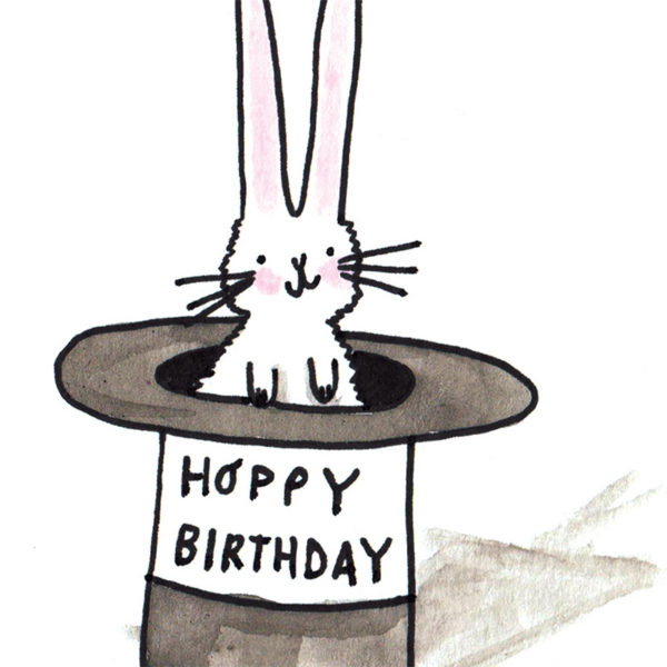 A white rabbit in a black top hat. On the top hat are the words 'Hoppy Birthday'.