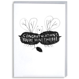 A black silhouette of two fuzzy bees who are kissing, one is holding a sprig of mint. Inside the silhouette it says in white 'Congratulations, you're mint twobee'.