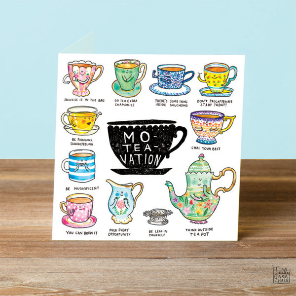 A blue background and a wooden table. On the table is a card. A black tea cup in the centre with text that reads 'Mo-Tea-Vation'. This is surrounded by eleven tea puns.