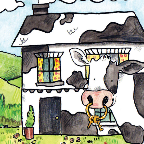 A black and white house behind a black and white cow, with keys hanging from the ring of its nose.