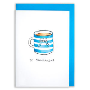 A card with a blue envelope tucked inside. A blue background and a grey wooden table. A white and blue striped mug full of tea.. The mug has little arms and is holding its hands to its cheeks. It has rosy cheeks and a little grin with happy, squinty eyes. Text below reads 'Be Mugnificent'.