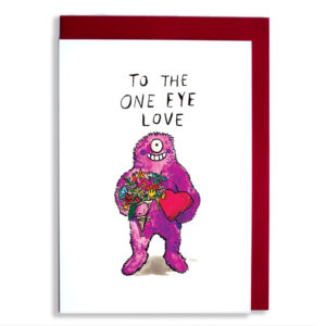 Red envelope with card. A smiley pink/purple fluffy monster with one eye is holding flowers and a heart shaped chocolate box. Text: To the one eye love'.
