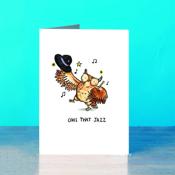 An owl with a bowler hat and stick is dancing surrounded by stars and music notes. Text below reads 'owl that jazz'.