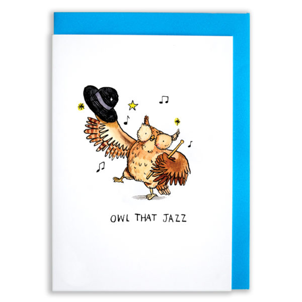 A card with a blue envelope tucked inside. An owl with a hat in one wing standing on one foot and dancing. The owl is surrounded by stars and music notes. Text below reads 'Owl That Jazz'.