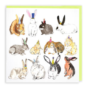 Card with pale green envelope. A card full of twelve different breeds of rabbit. All are wearing colourful party hats.