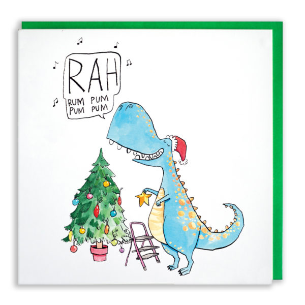 A blue dinosaur is wearing a Santa hat and dressing a little tree. He is singing 'Rah rum pum pum pum'.