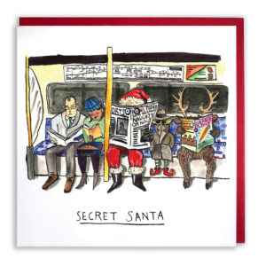 An elf, a reindeer and Santa are all trying to blend in on the tube. Santa is reading a newspaper. Text reads: 'Secret Santa'.