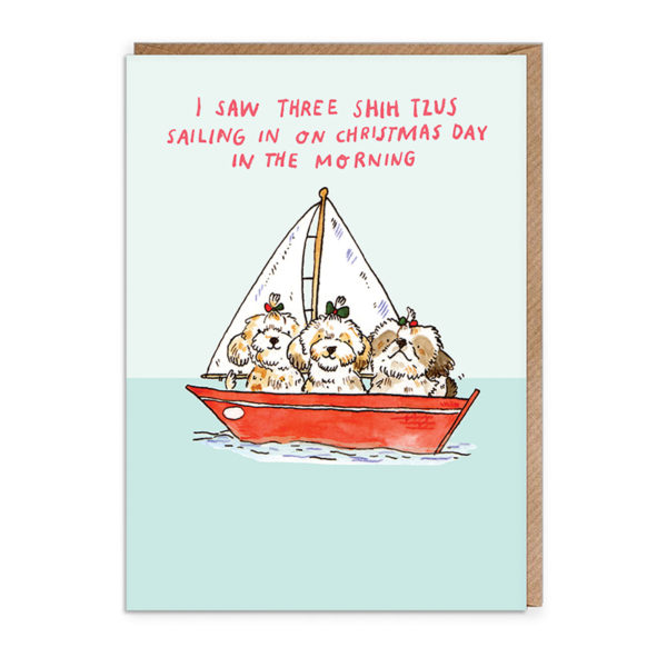 Top half of card very light blue, bottom light blue. A red sail boat with three Shih Tzus inside it. Text reads 'I saw three shih tzus sailing in on Christmas day in the morning.