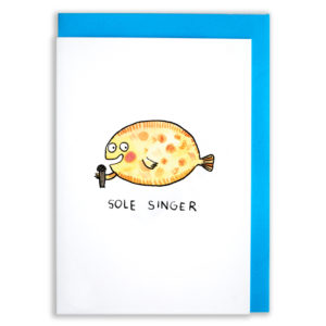 A card with a blue envelope tucked inside. A yellow sole with orange dots. The sole has a happy face and is singing into a microphone. The words 'sole singer' are below.